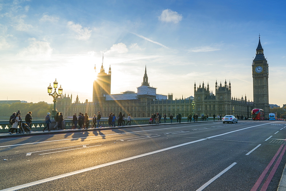 Pedestrians on Westminster Bridge with Houses of Parliament and Big Ben at sunset, London, England, United Kingdom, Europe