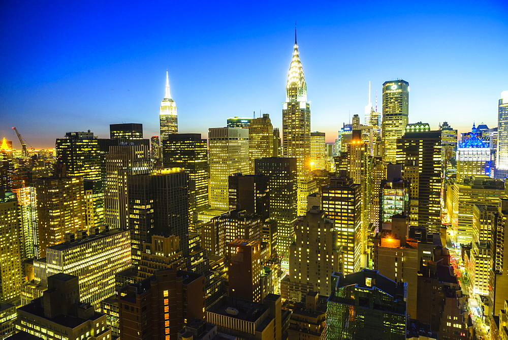 The Empire State and Chrysler buildings, Manhattan skyline at dusk, New York City, USA
