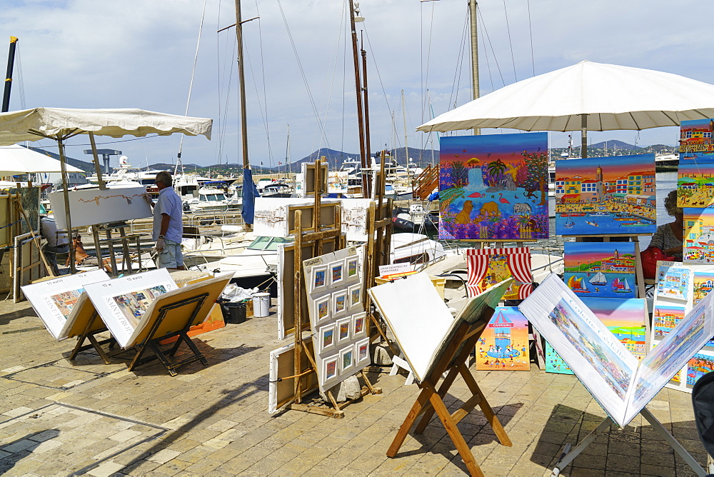 Art for sale by the harbour, Saint Tropez, Var, Cote d'Azur, Provence, French Riviera, France, Mediterranean, Europe