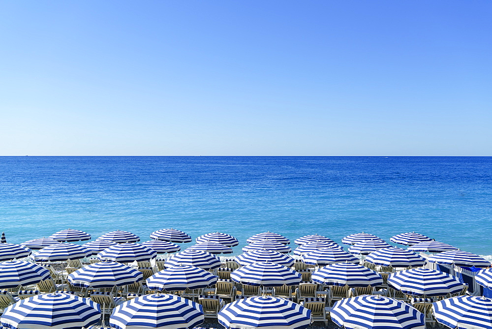 Blue and white beach parasols, Nice, Cote d'Azur, Alpes-Maritimes, Provence, French Riviera, France, Mediterranean, Europe