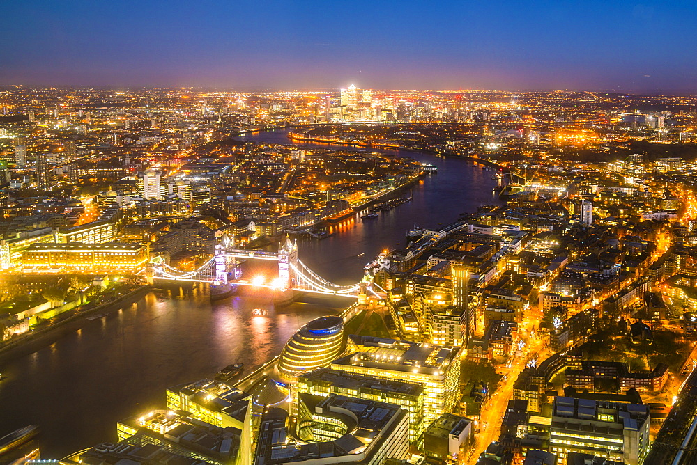High view of London skyline at night along the River Thames from Tower Bridge to Canary Wharf, London, England, United Kingdom, Europe - 1226-283