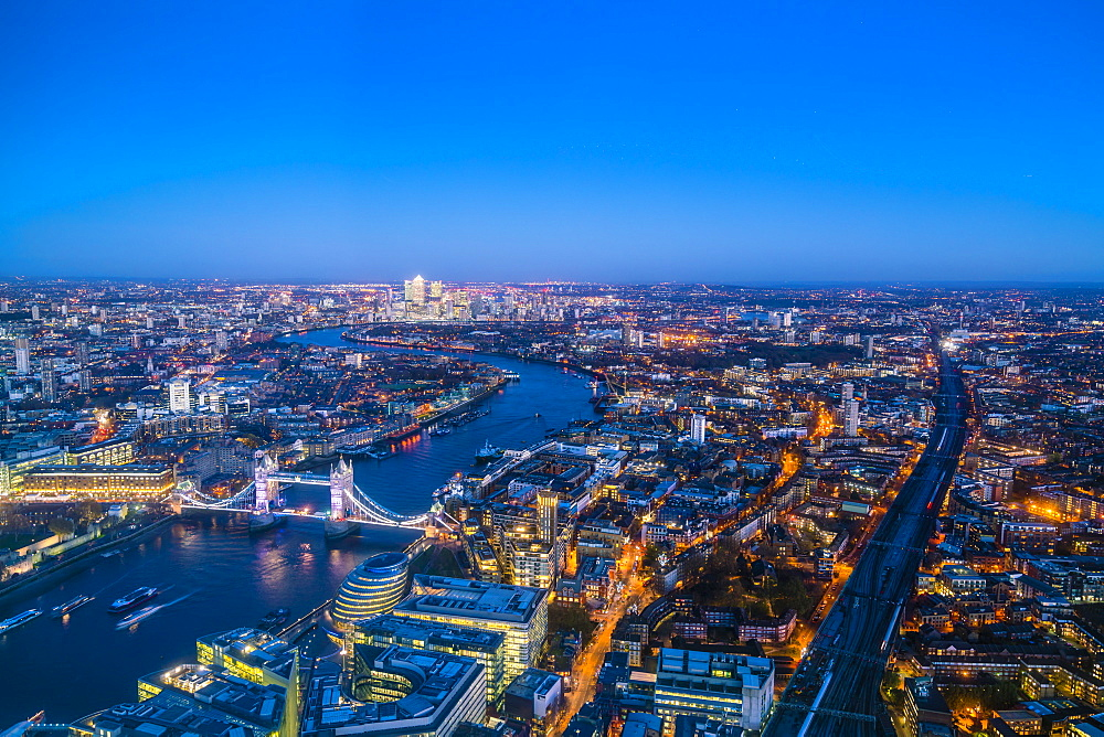 High view of London skyline at dusk along the River Thames from Tower Bridge to Canary Wharf, London, England, United Kingdom, Europe