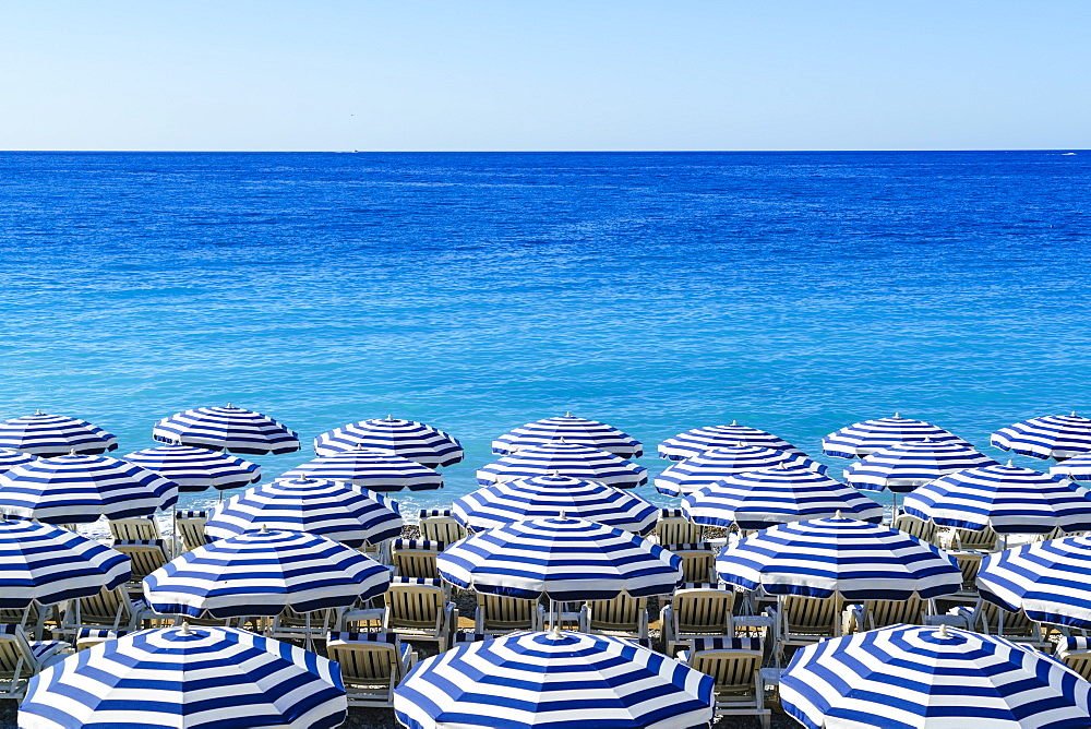 Blue and white beach parasols, Nice, Cote d'Azur, France