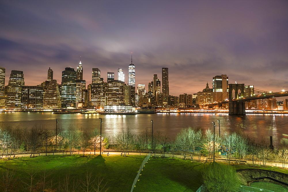 Manhattan skyline and Brooklyn Bridge, before sunrise, New York City, United States of America, North America