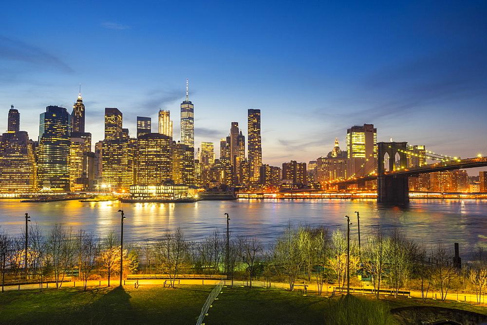 Manhattan skyline and Brooklyn Bridge at dusk, New York City, USA