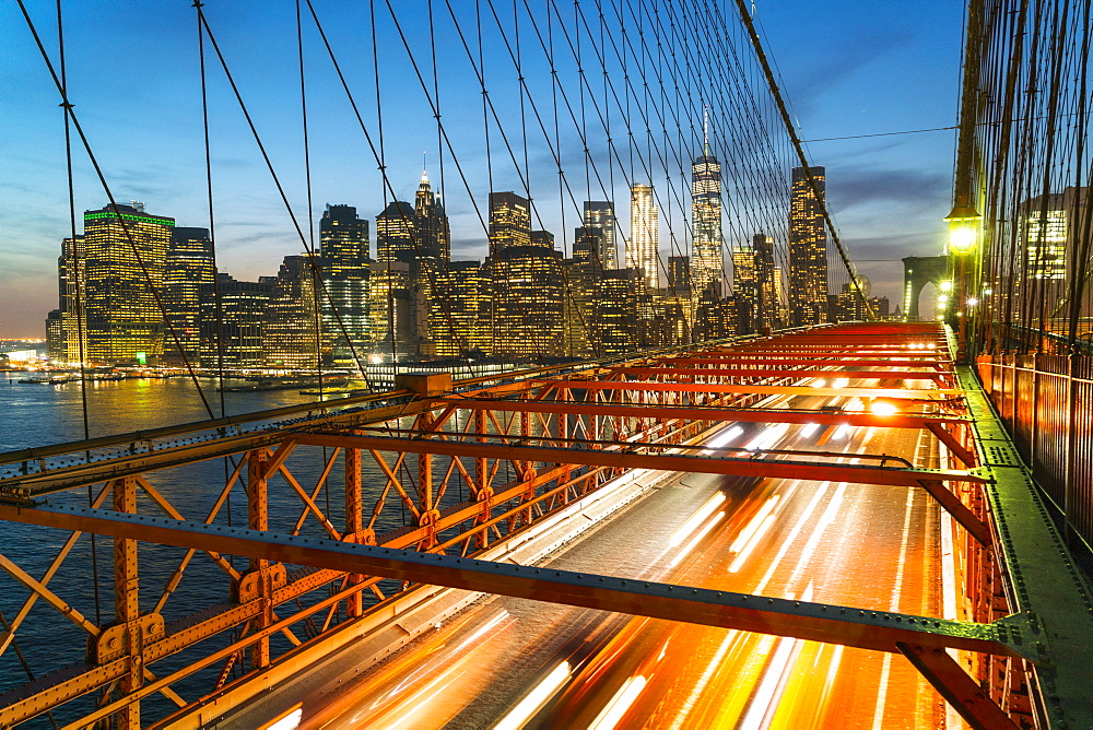 Rush hour traffic at night on Brooklyn Bridge and Manhattan skyline beyond, New York City, United States of America, North America