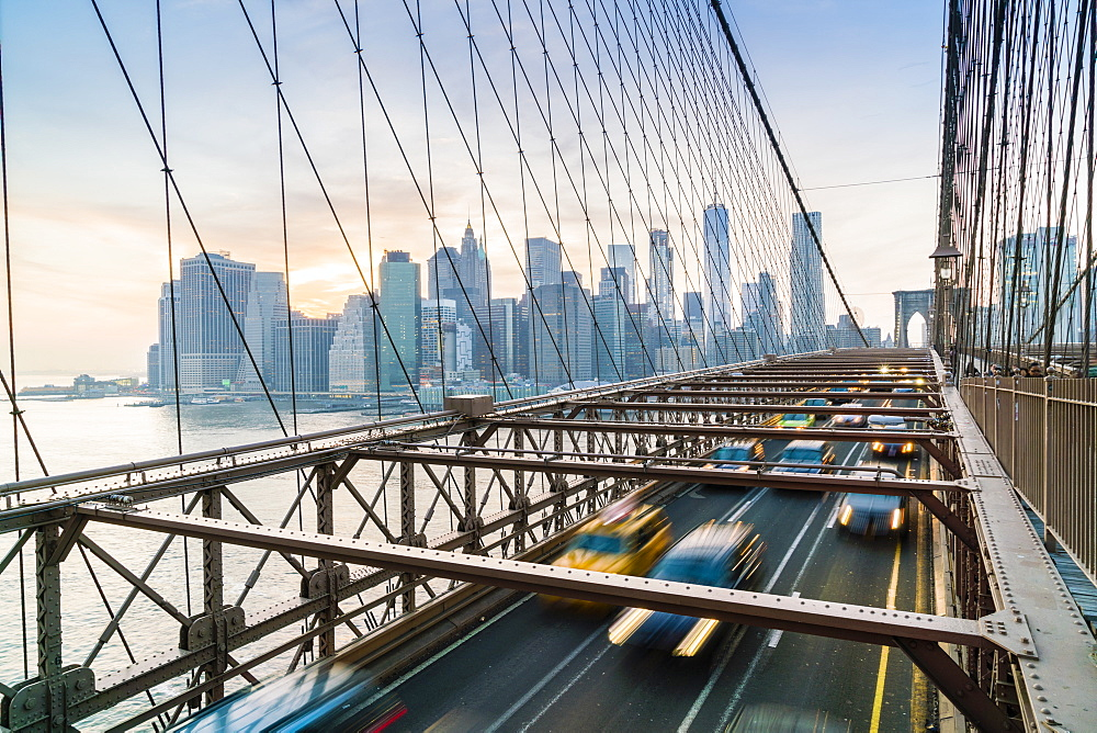 Rush hour traffic on Brooklyn Bridge and Manhattan skyline beyond, New York City, USA