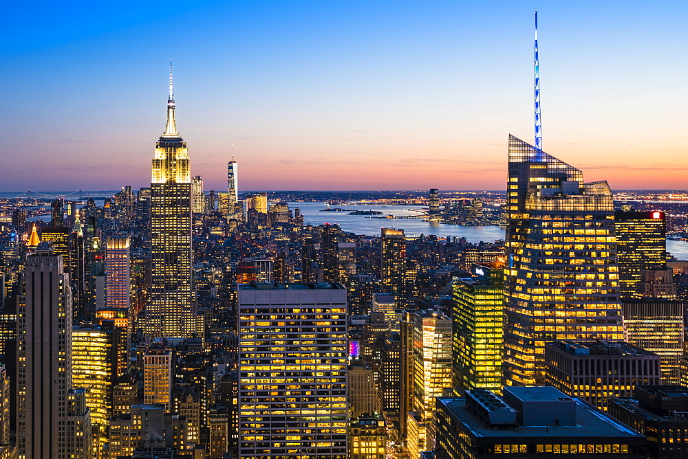 Manhattan skyline and Empire State Building at dusk, New York City, USA