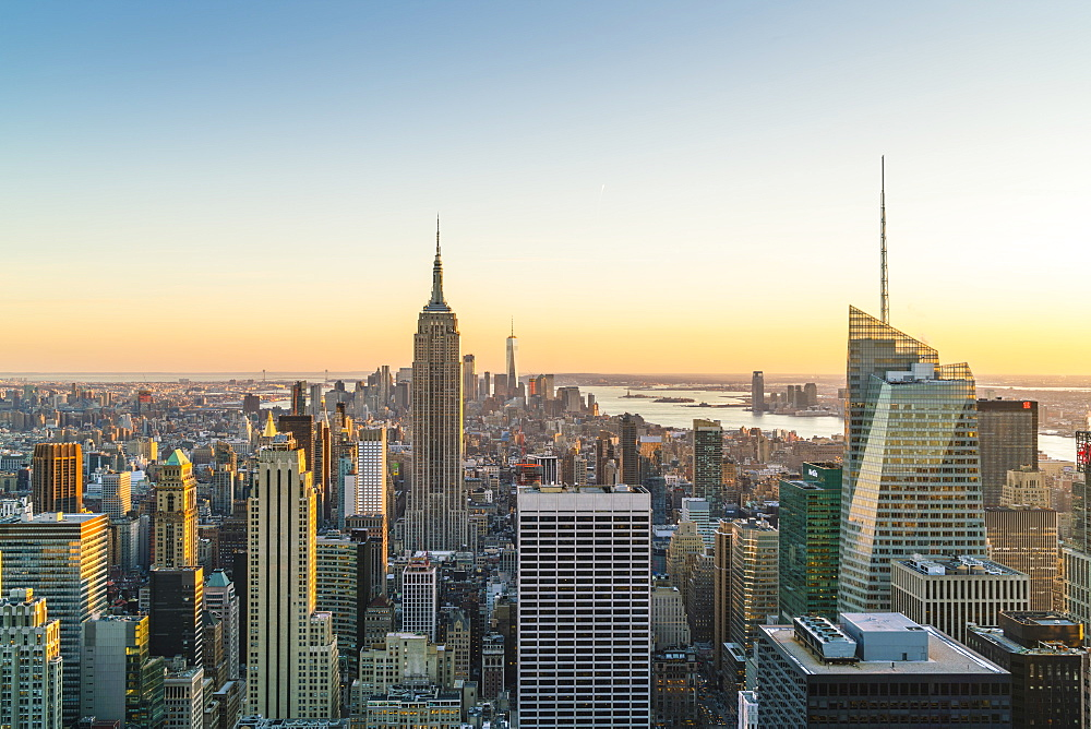Manhattan skyline and Empire State Building, sunset, New York City, United States of America, North America