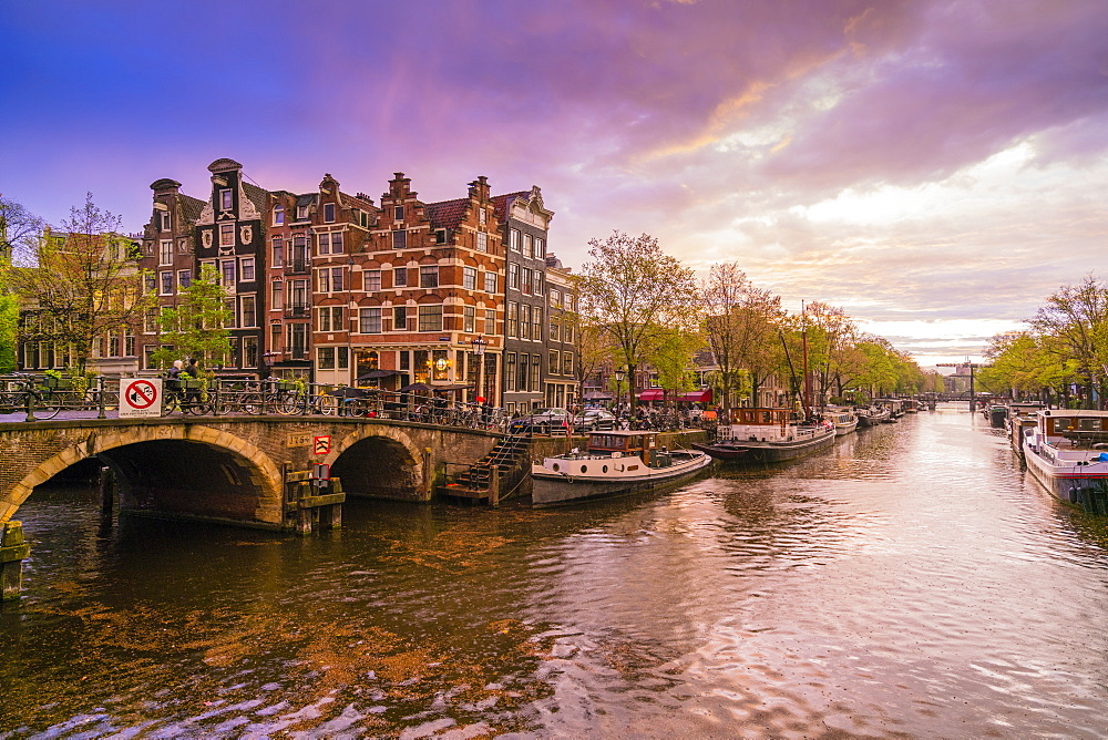 Canal scene at dusk, Amsterdam, Netherlands, Europe