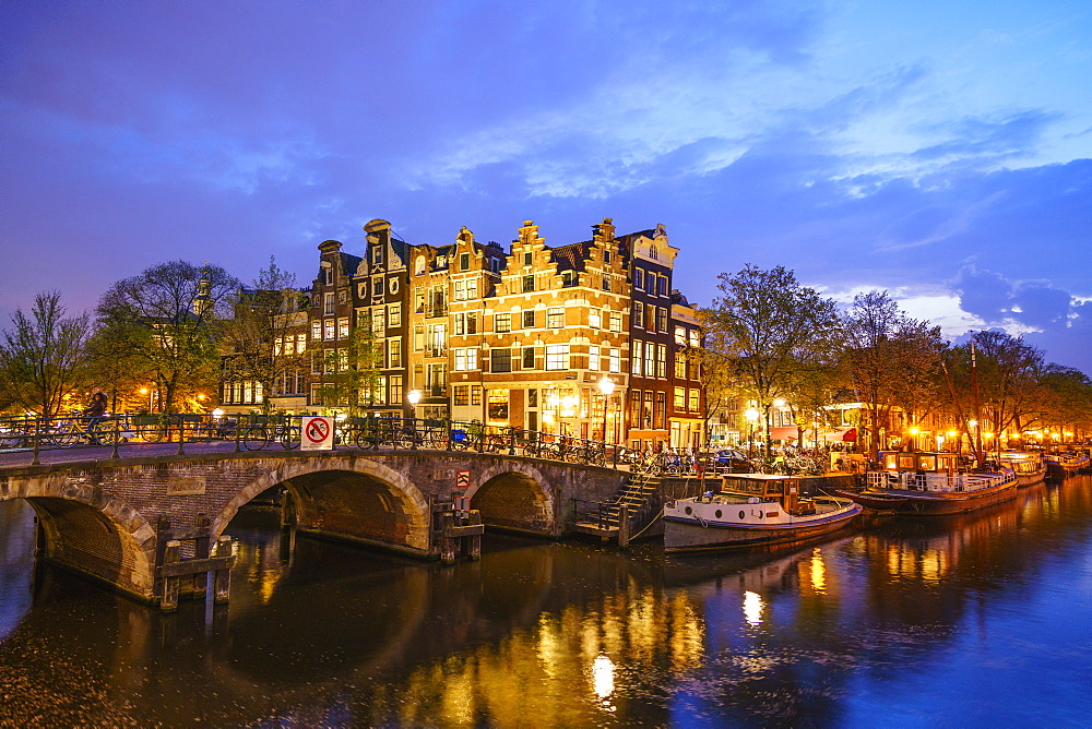 Canal scene at night, Amsterdam, Netherlands, Europe