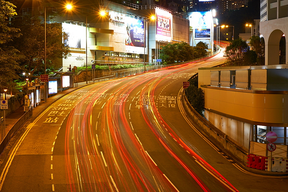 Car light trails on a busy road in Central, Hong Kong Island by night, Hong Kong, China, Asia