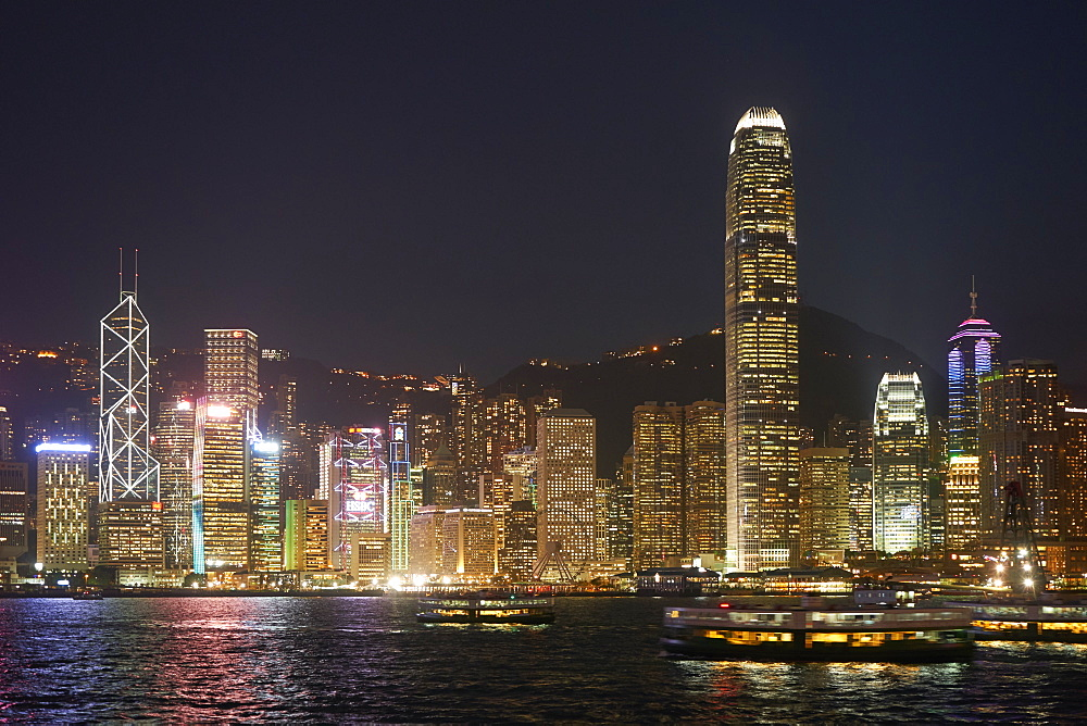 Hong Kong skyline at night showing the financial centre on Hong Kong Island with Bank of China Tower and Two International Finance Centre (2IFC), Hong Kong, China, Asia