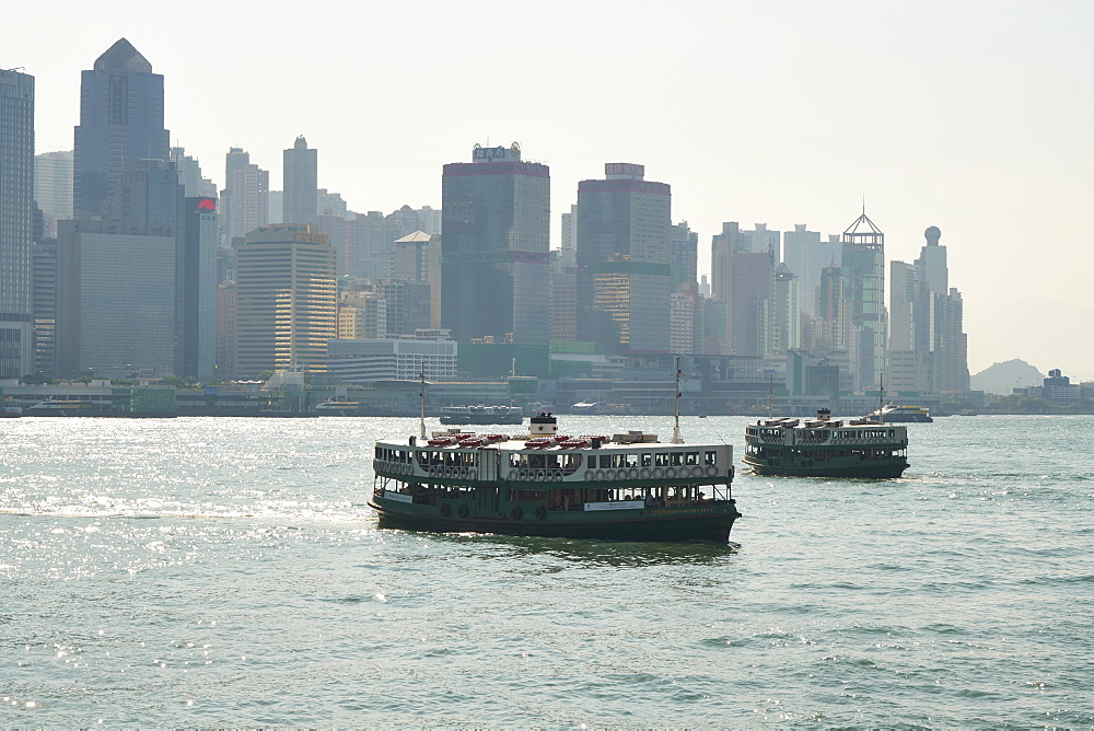 Star Ferry crossing Victoria Harbour from Hong Kong Island to Kowloon, Hong Kong, China, Asia