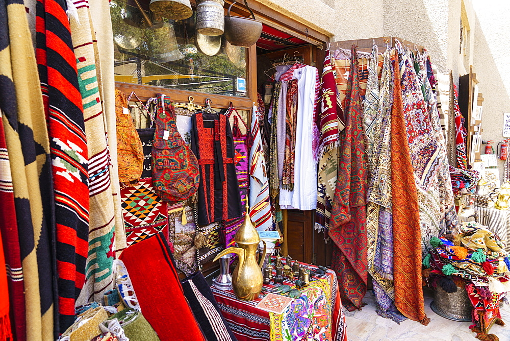 Colourful rugs and carpets for sale in Al Fahidi Historic Neighbourhood, Bur Dubai, Dubai, United Arab Emirates, Middle East