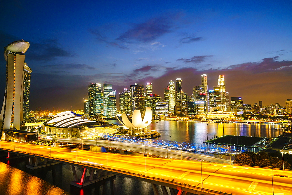 Busy roads leading to the Marina Bay Sands, Gardens by the Bay and ArtScience Museum at dusk with the skyline beyond, Singapore, Southeast Asia, Asia
