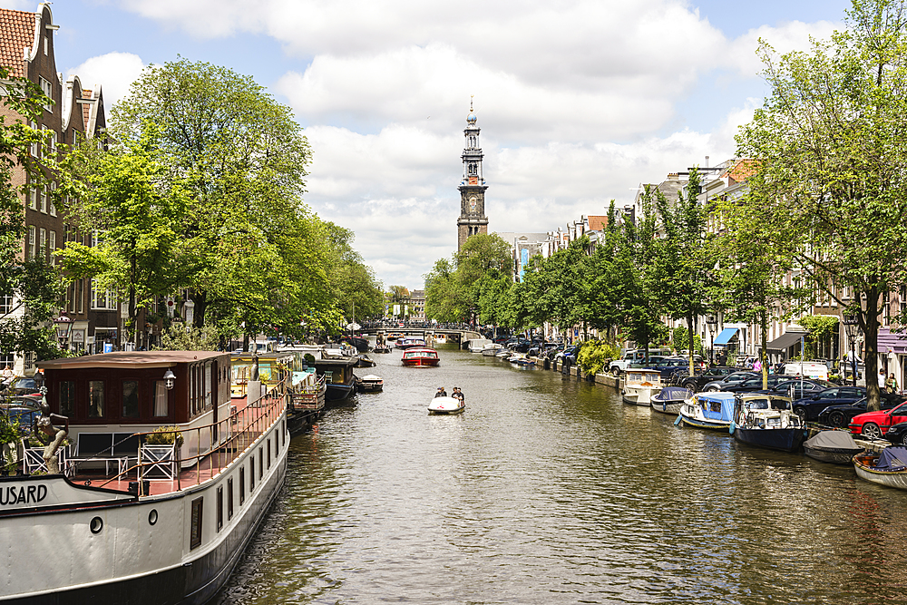 Prinsengracht canal looking towards Westerkerk church, Amsterdam, North Holland, The Netherlands, Europe