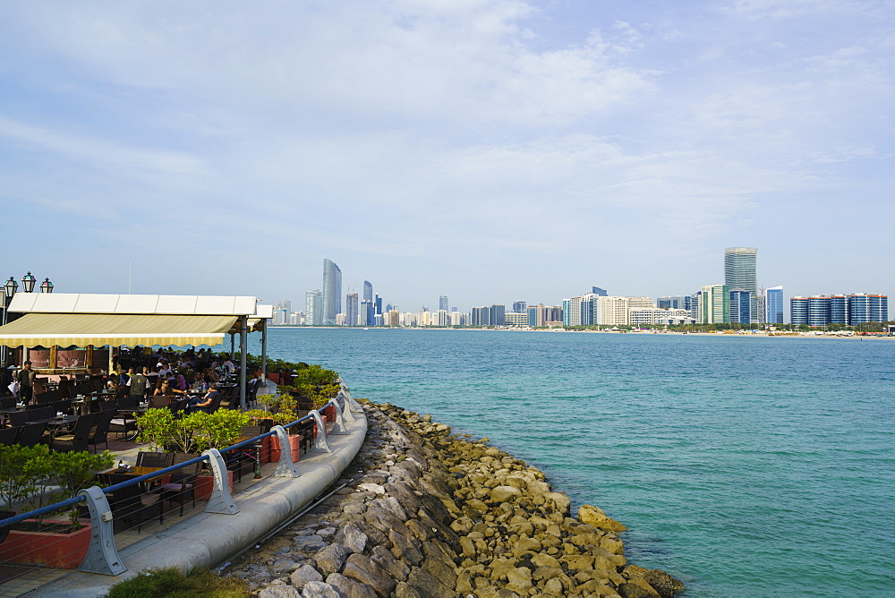 Restaurant overlooking the skyline across the Gulf, Abu Dhabi, United Arab Emirates, Middle East
