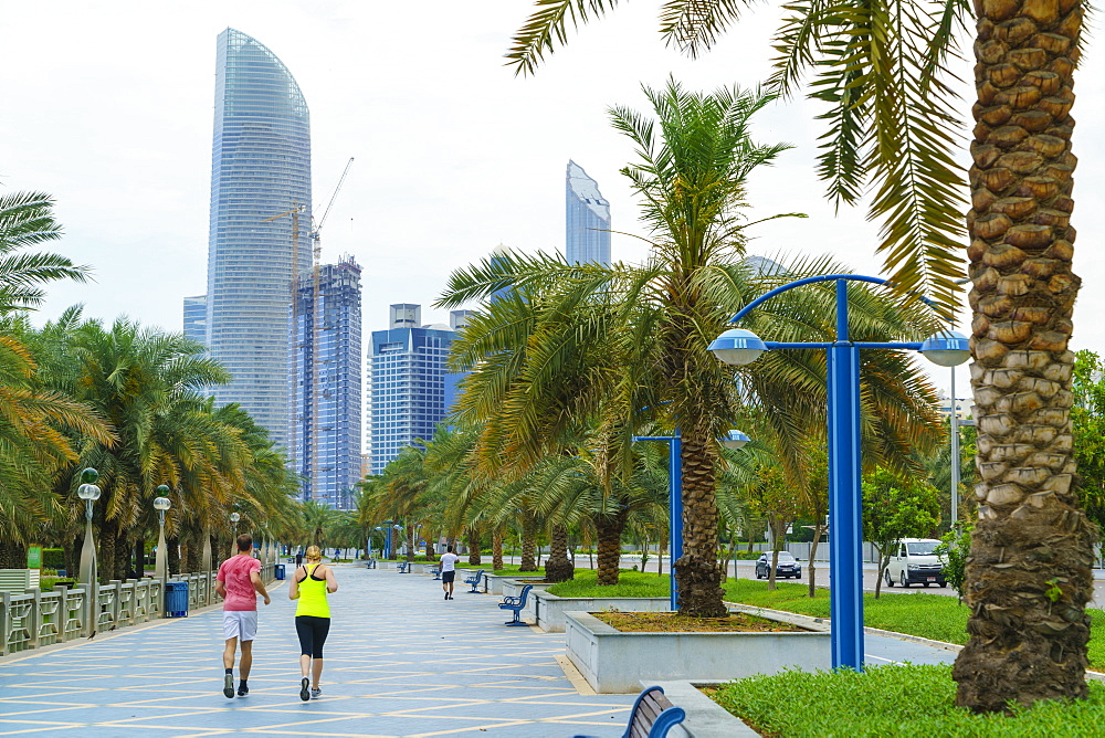 Joggers on the Corniche, Abu Dhabi, United Arab Emirates, Middle East