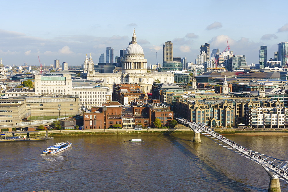 High view of St. Paul's Cathedral and City of London skyline with River Thames and Millennium Bridge in foreground, London, England, United Kingdom, Europe