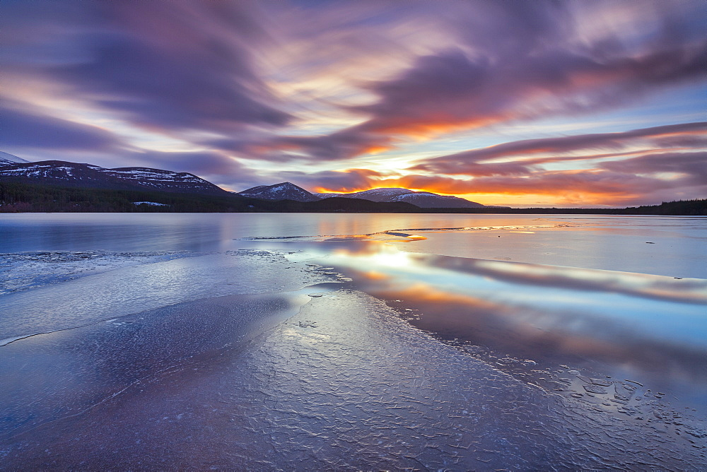 Ice sheets and sunset at Loch Morlich, Glenmore, Scotland, United Kingdom, Europe