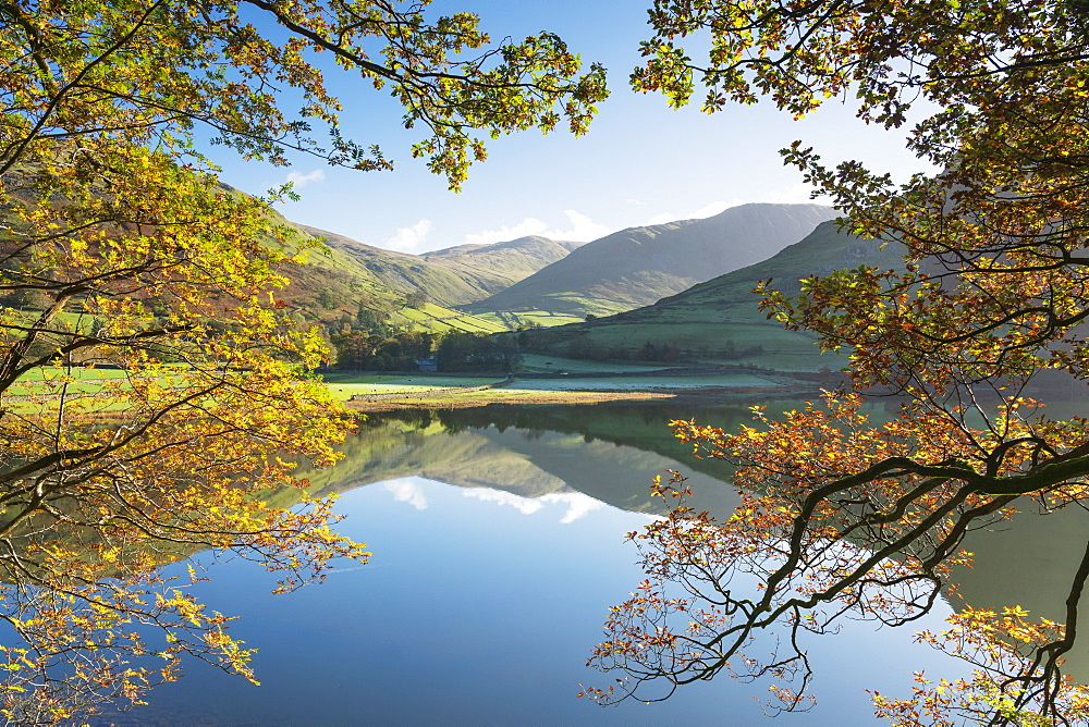 Autumn colours and clear reflections in Brothers Water, The Lake District, England