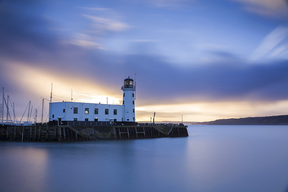A long exposure photograph of Scarborough Lighthouse shortly after sunrise, Scarborough, North Yorkshire, Yorkshire, England, United Kingdom, Europe