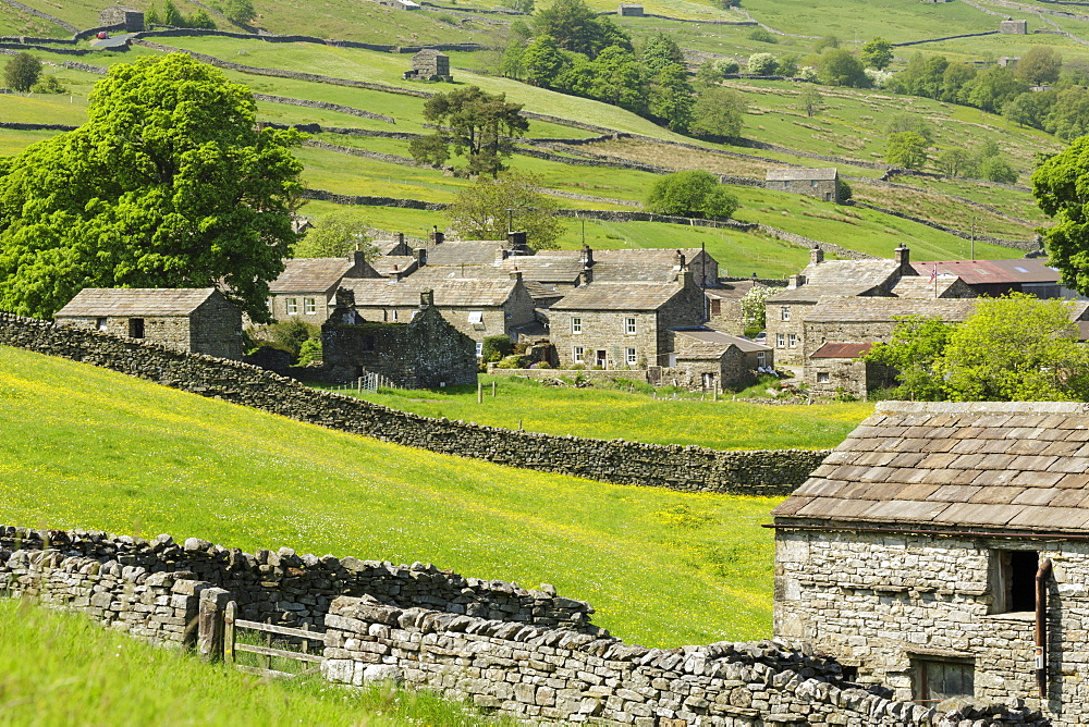 Stone cottages at the remote village of Thwaite in upper Swaledale, The Yorkshire Dales, Yorkshire, England, United Kingdom, Europe - 1228-72