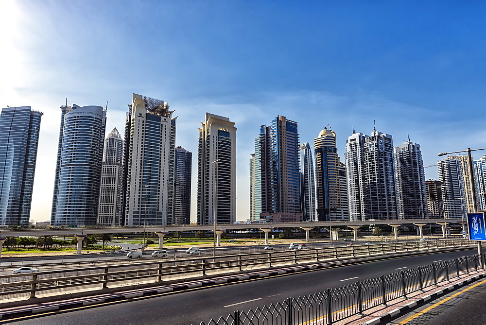 A row of skyscrapers line the Dubai skyline, Downtown Dubai, United Arab Emirates, Middle East - 1231-10