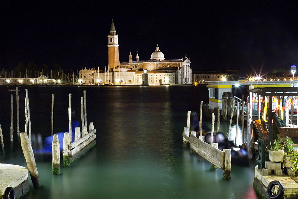 The island and church of San Georgio Maggiore at night with a boat dock in the foreground, Venice, UNESCO World Heritage Site, Veneto, Italy, Europe - 1231-3