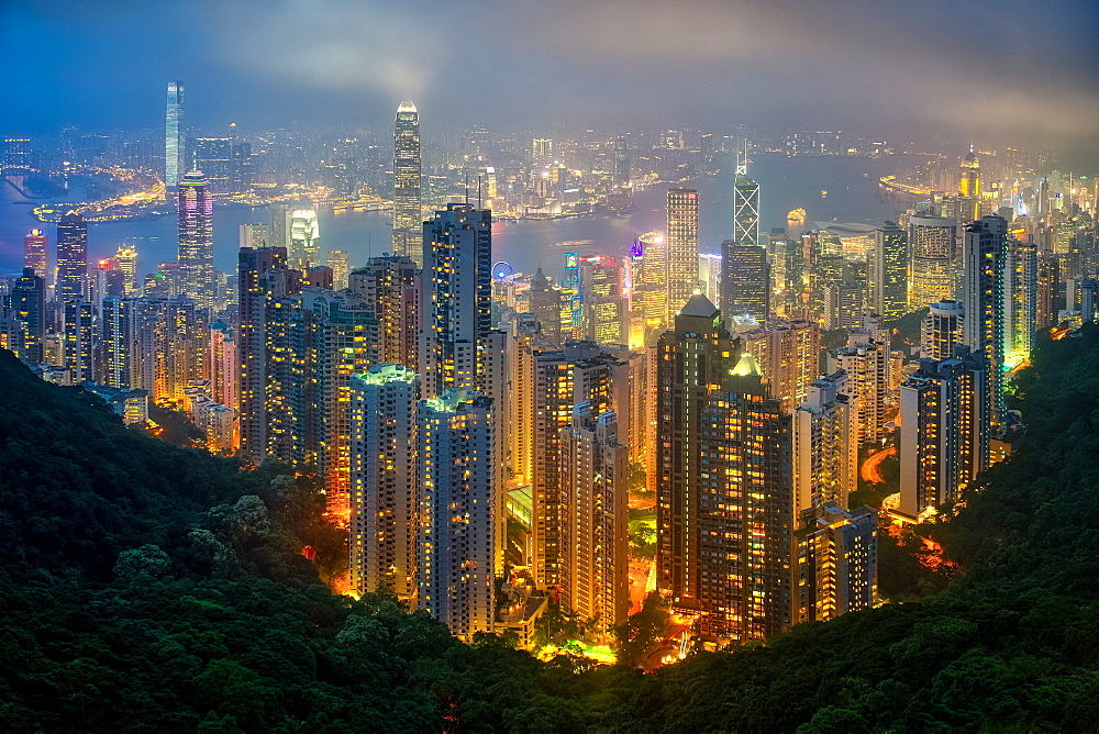 Fog envelops Hong Kong on a summer night seen from Victoria Peak, Hong Kong, China, Asia