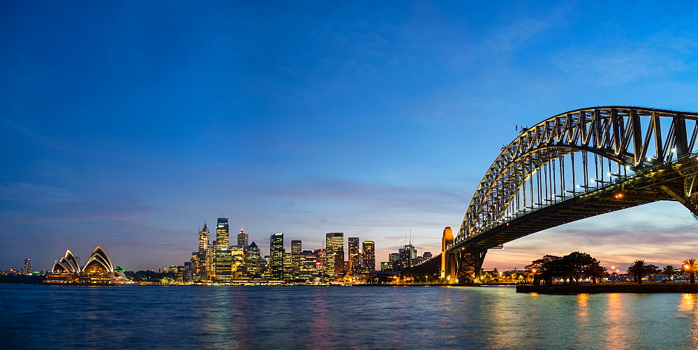 Sydney's iconic buildings lit up as dusk settles over the city, Sydney, New South Wales, Australia, Pacific