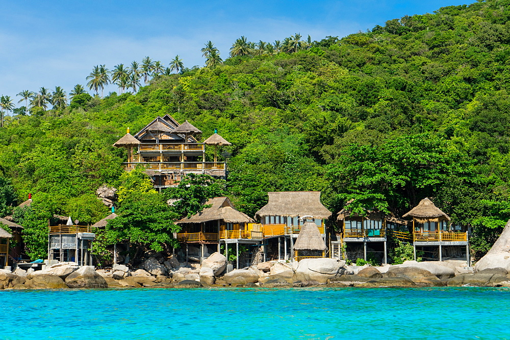 A traditional Thai resort overlooks turquoise water on the tropical island of Koh Tao, Thailand, Southeast Asia, Asia