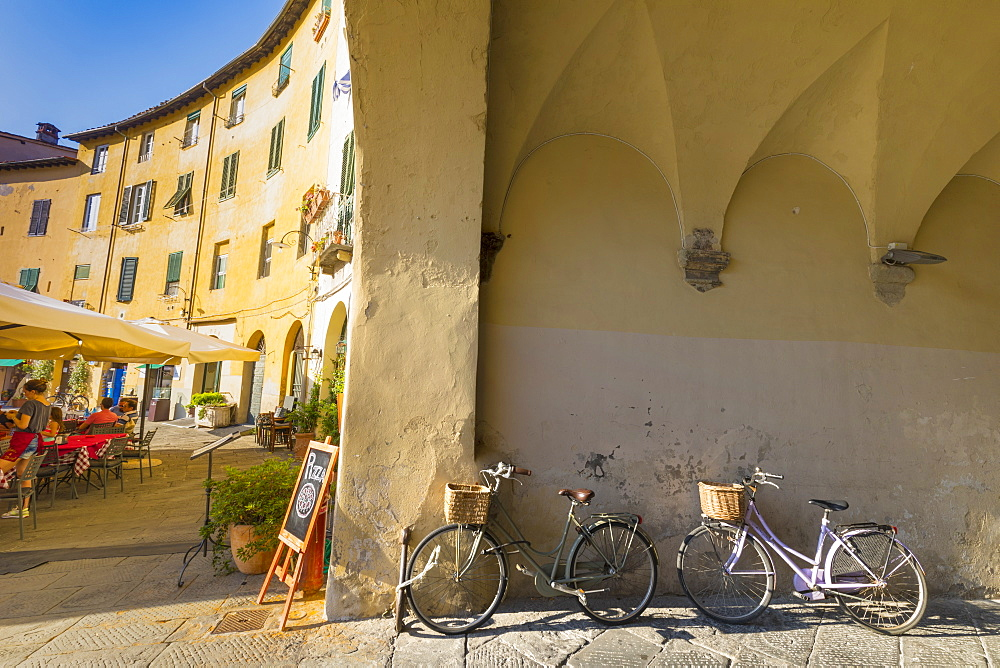 Parked bicycles at Piazza dell Anfitreatro, Lucca, Tuscany, Italy, Europe