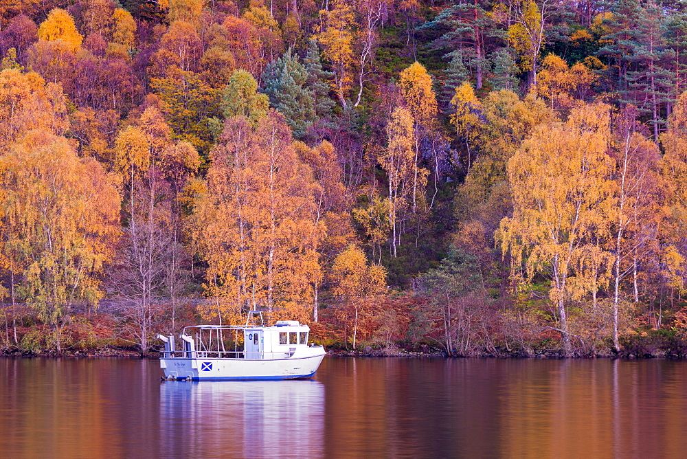 Boat moored at Loch Katrine, Autumn Colours, The Trossachs, Scotland, United Kingdom, Europe.