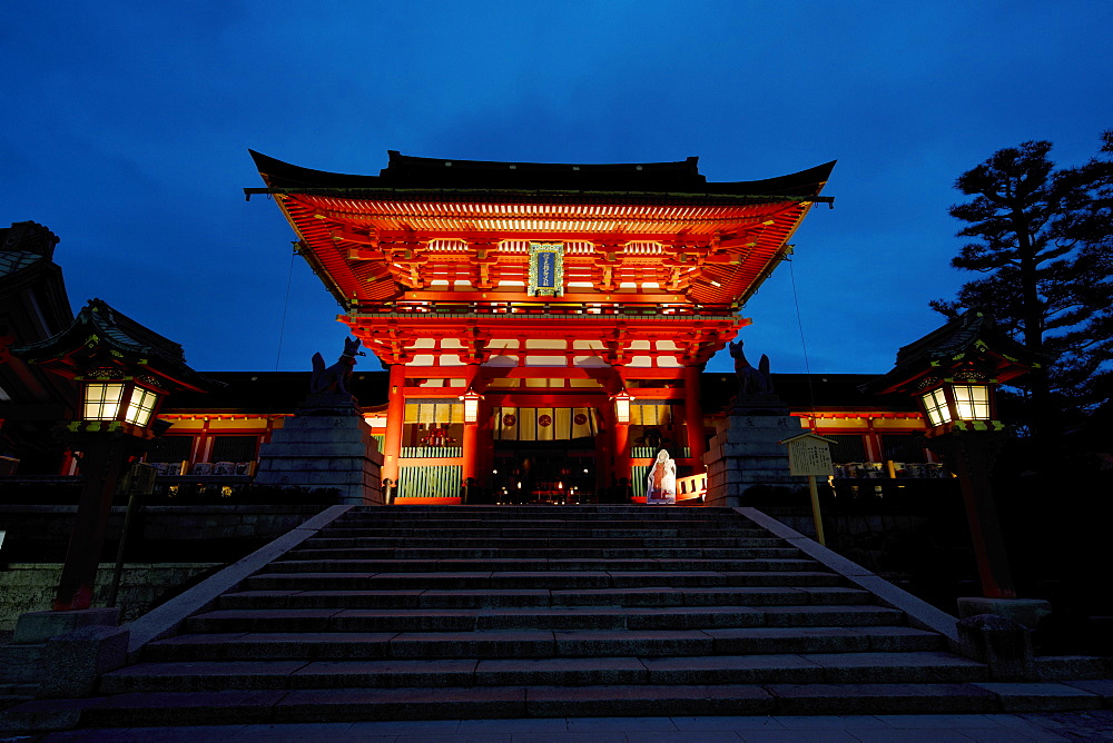 Fushimi Inari shrine entrance gate at dusk, Kyoto, Japan, Asia
