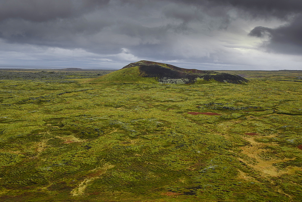 Volcanic crater and moss-covered lava fields on the Snaefellsness Peninsula, Iceland, Polar Regions