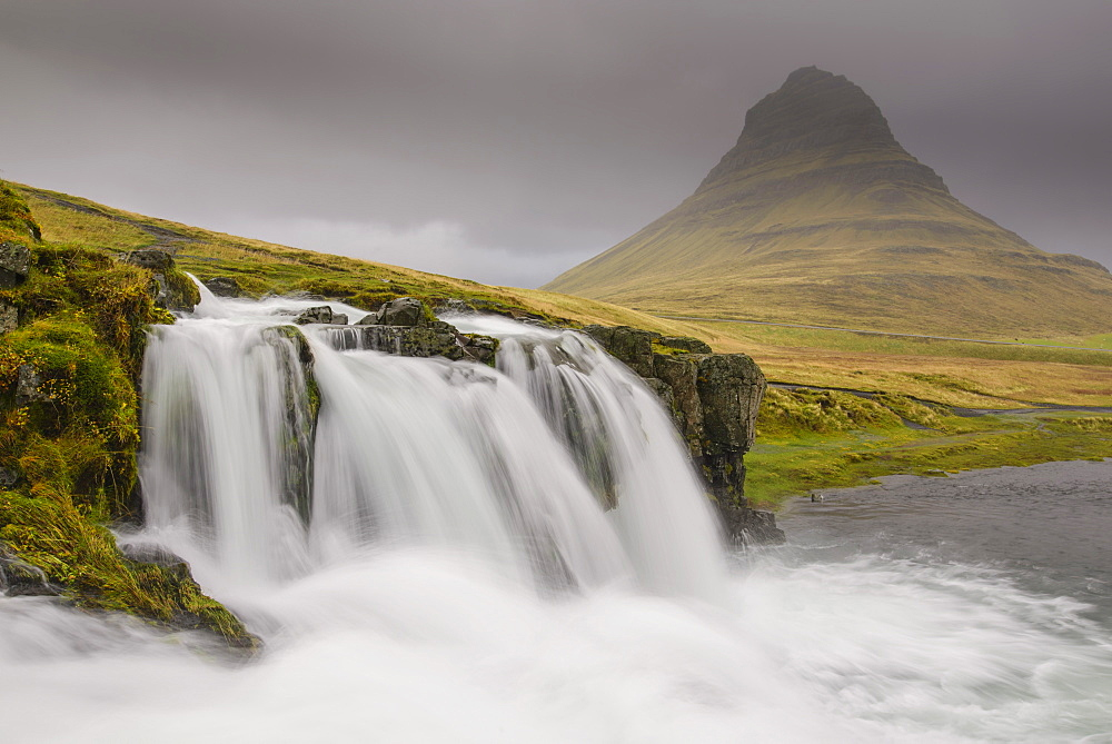 Kirkjufellsfoss on a cloudy day on the Snaefellsness Peninsula, Iceland, Polar Regions