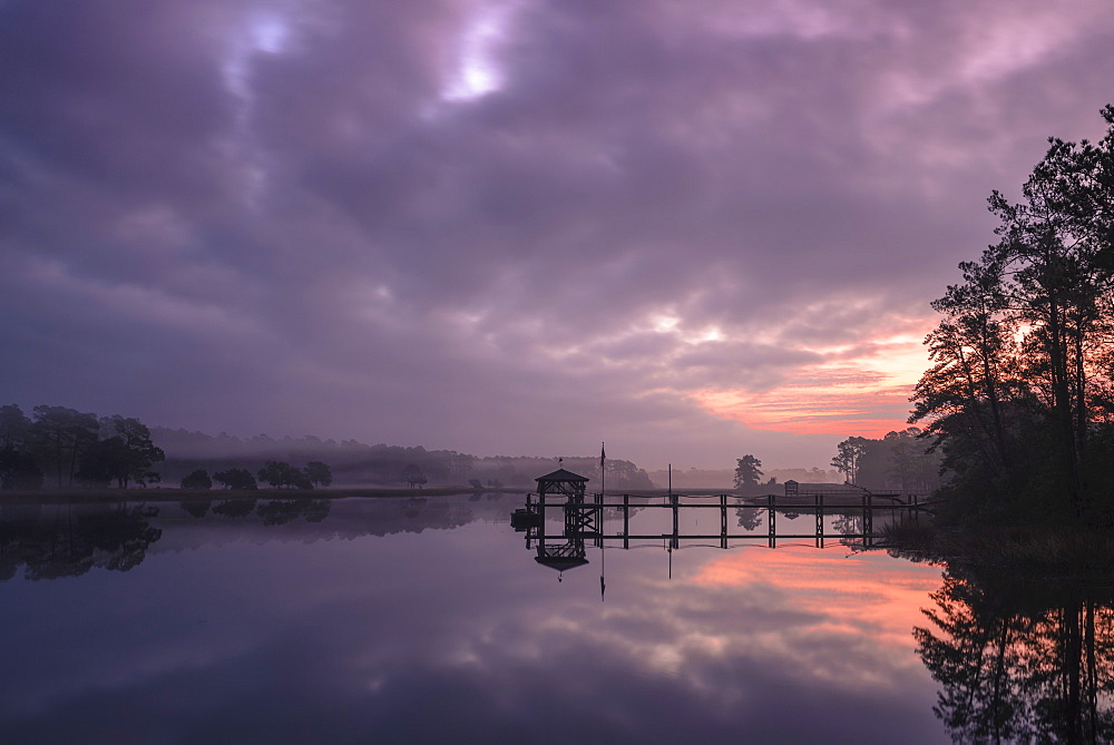 Sunrise and dock on intracoastal waterway, Calabash, North Carolina, United States of America, North America