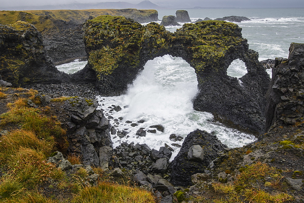 Gatklettur basalt rock arch on the Snaefellsness Peninsula, Iceland, Polar Regions