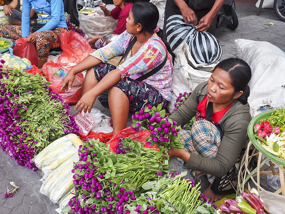 Flower sellers at a market, Denpasar, Bali, Indonesia, Southeast Asia, Asia