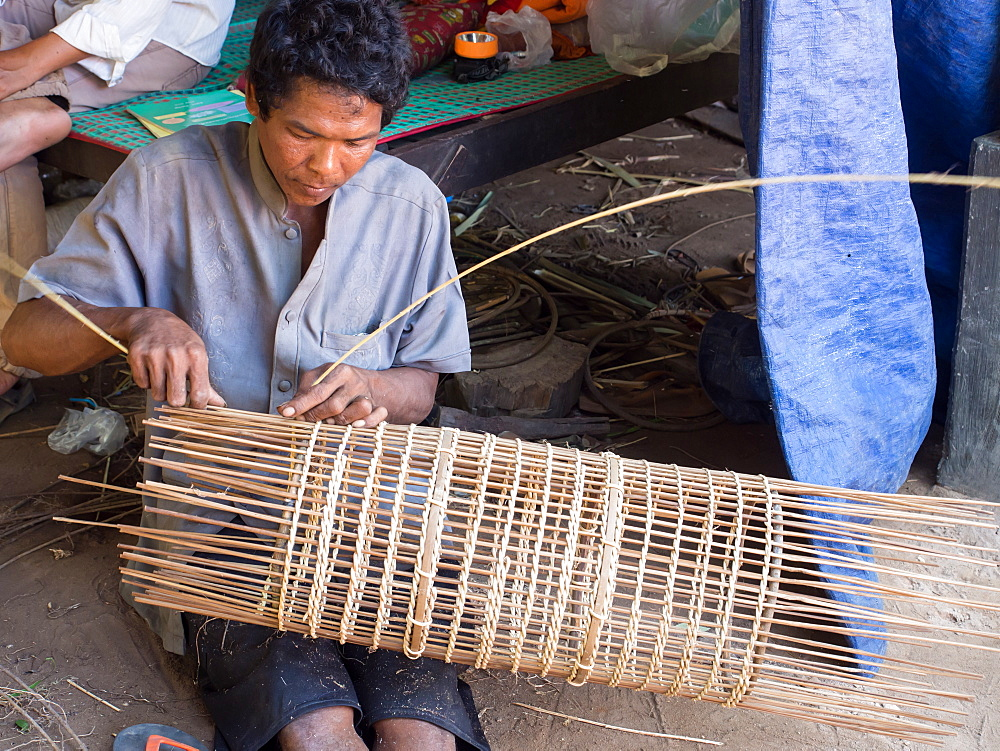Man making a fish trap, village near Siem Reap, Cambodia, Indochina, Southeast Asia, Asia