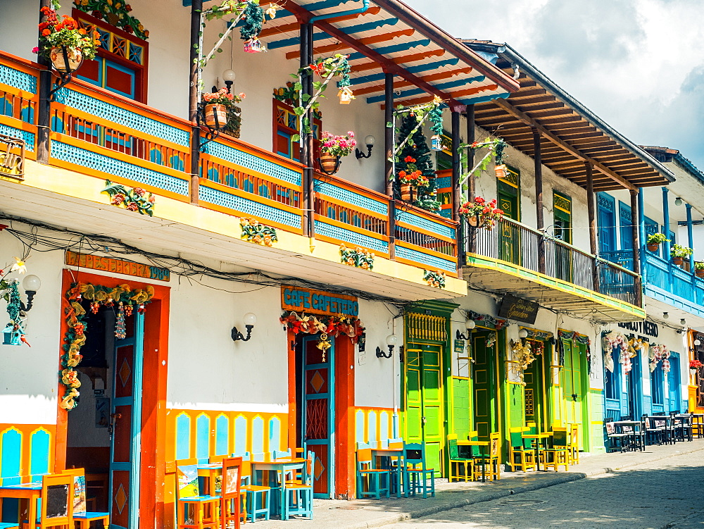 Colorful houses line the Parque Principal, Jardin, Antioquia, Colombia, South America