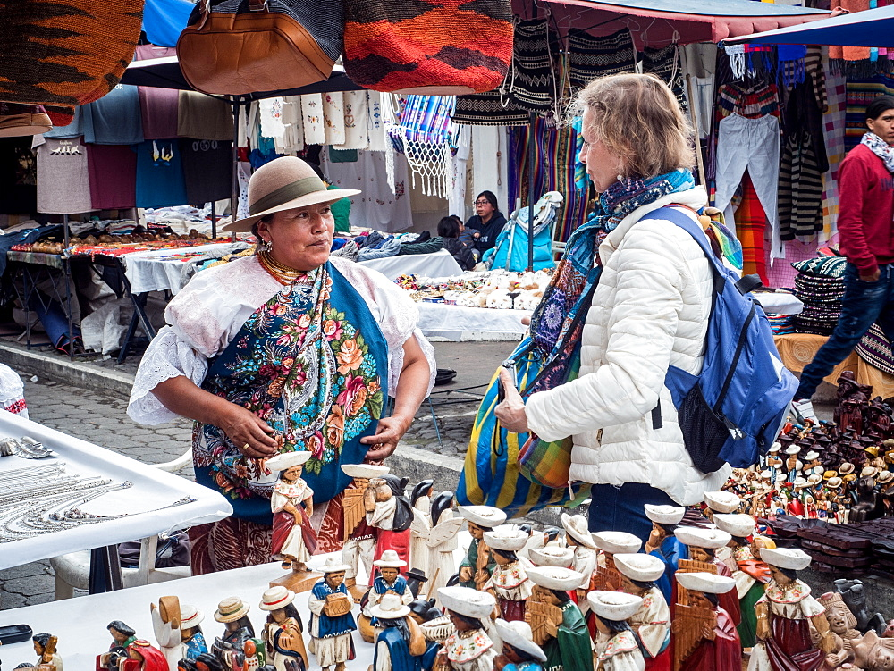 Tourist shopping at market, Plaza de los Ponchos, Otavalo, Ecuador, South America