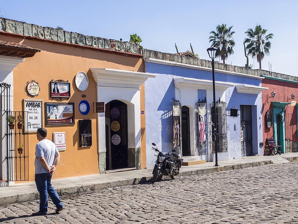 Street scene of colorful buildings, Oaxaca, Mexico, North America