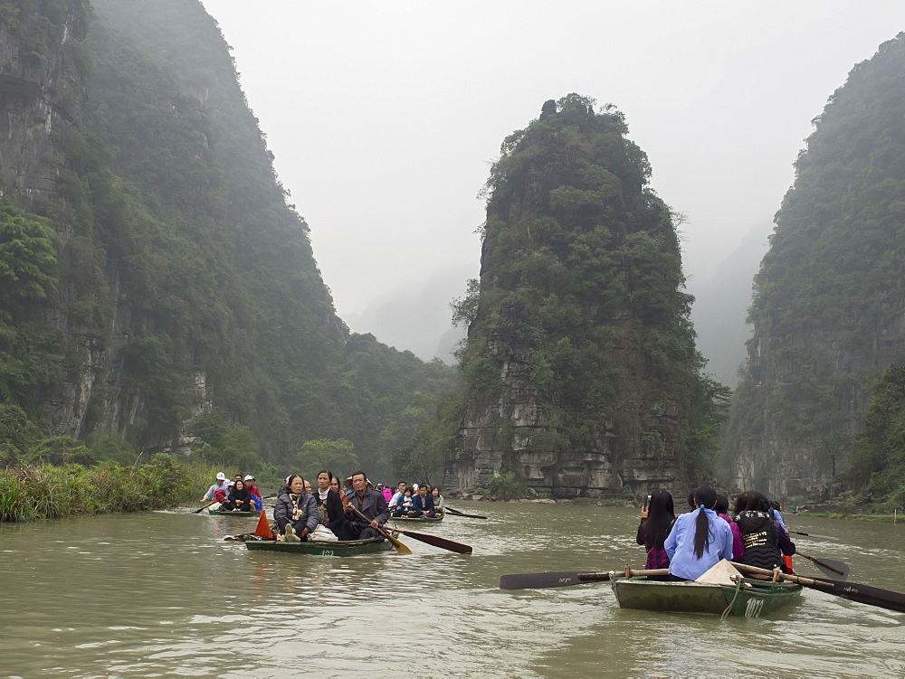 Tourist rowboats on the river, Tam Coc, Vietnam, Indochina, Southeast Asia, Asia