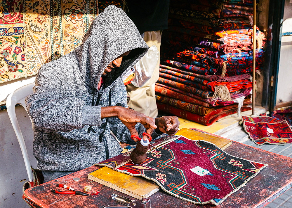A man hand making a carpet in Tel Aviv, Israel, Middle East