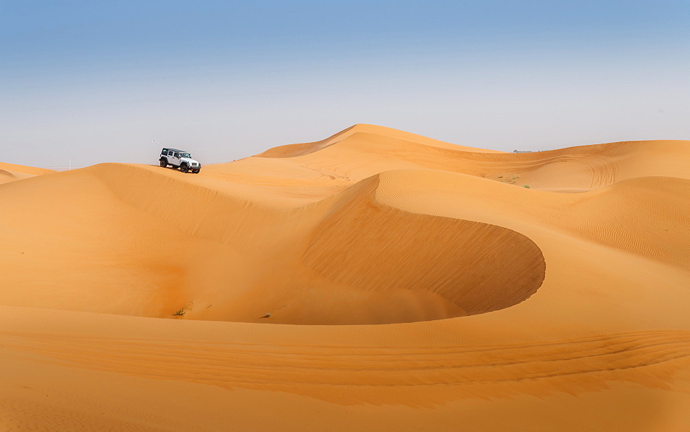 Offroad vehicle on sand dunes near Dubai, United Arab Emirates, Middle East