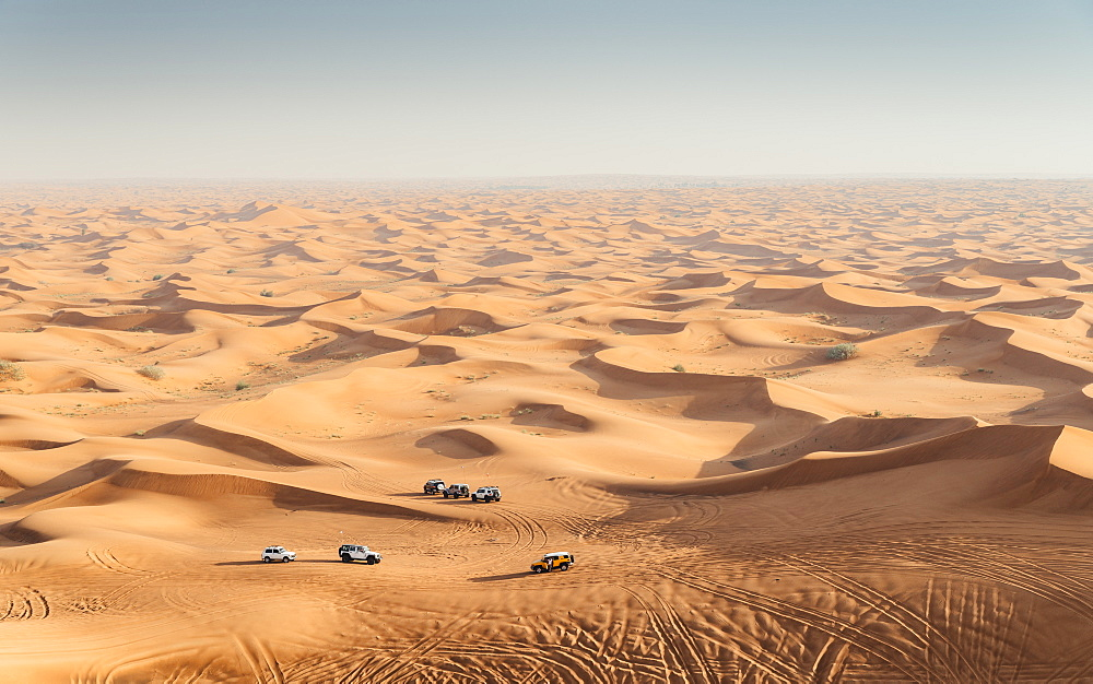Offroad vehicles on sand dunes near Dubai, United Arab Emirates, Middle East