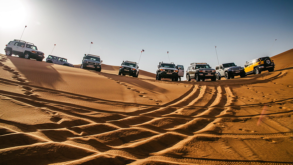 Off road vehicles on sand dunes near Dubai, United Arab Emirates, Middle East